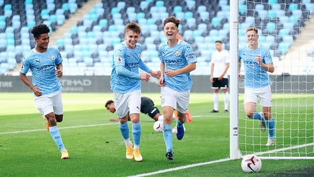 ALL SMILES: James McAtee and Co celebrate after his opener for City