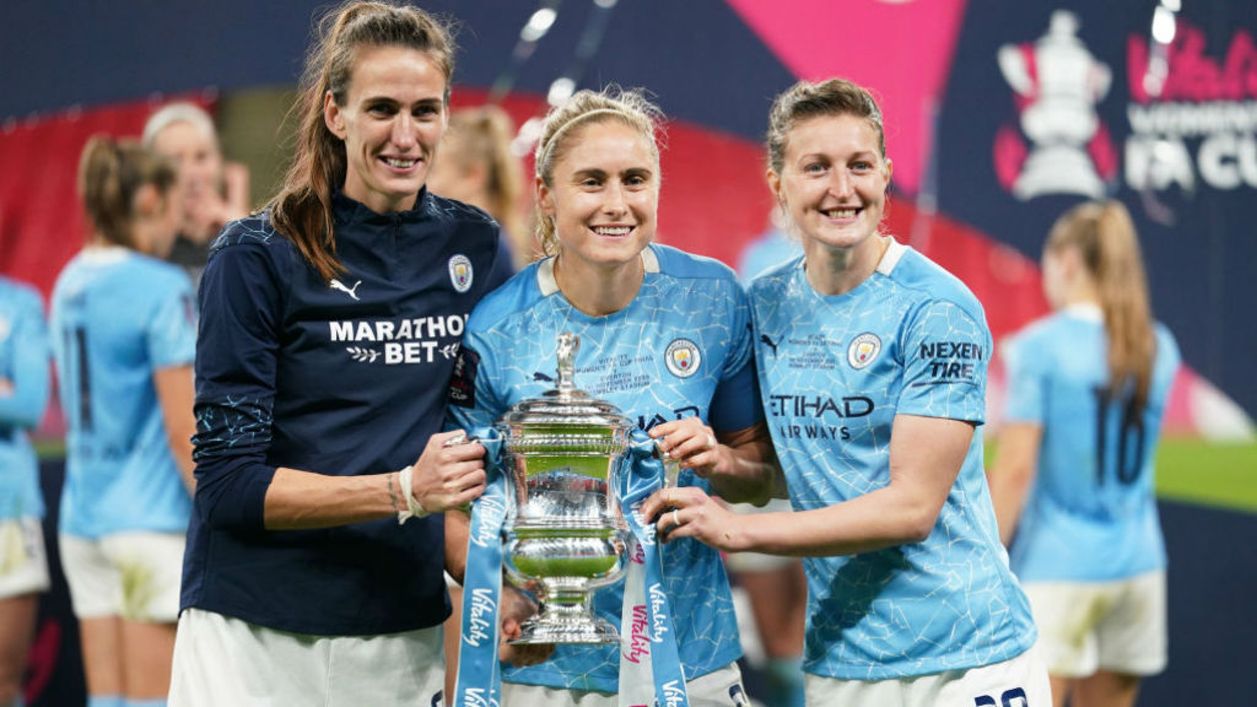 THREE CHEERS: Jill celebrates winning the FA Women's Cup for the third time after this month's win over Everton alongside City and England colleagues Steph Houghton and Ellen White