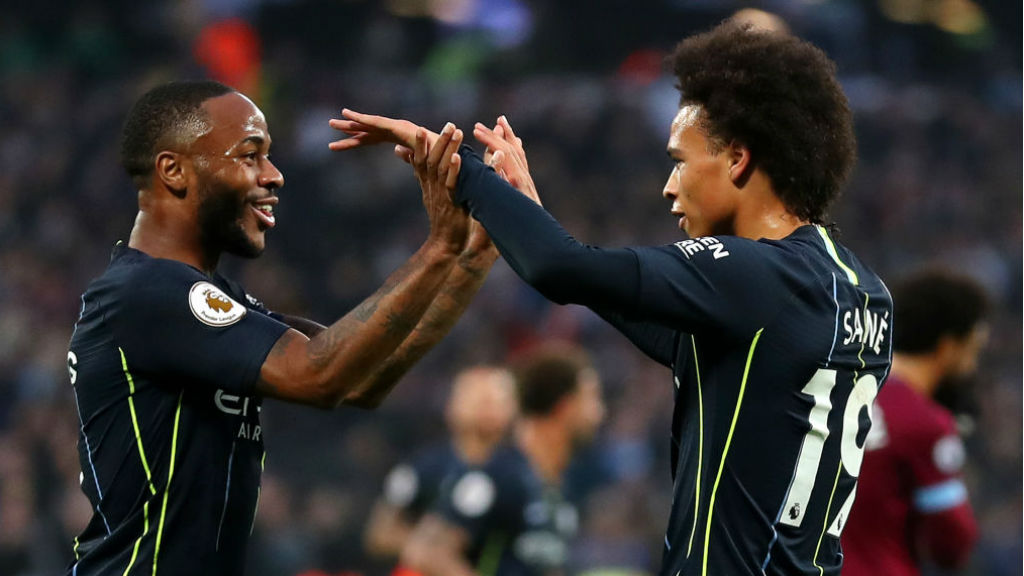 TWO'S COMPANY : Leroy and Raheem are all smiles after our third goal