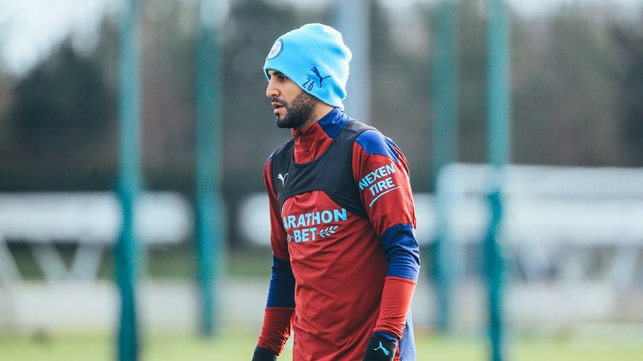 HAT TRICK: Riyad Mahrez was suitably kitted out to deflect the January chill