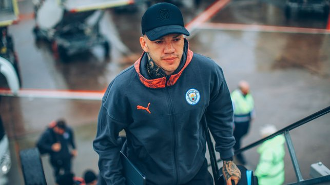 CAP THAT : Ederson sported a neat looking baseball cap as he boarded the aircraft