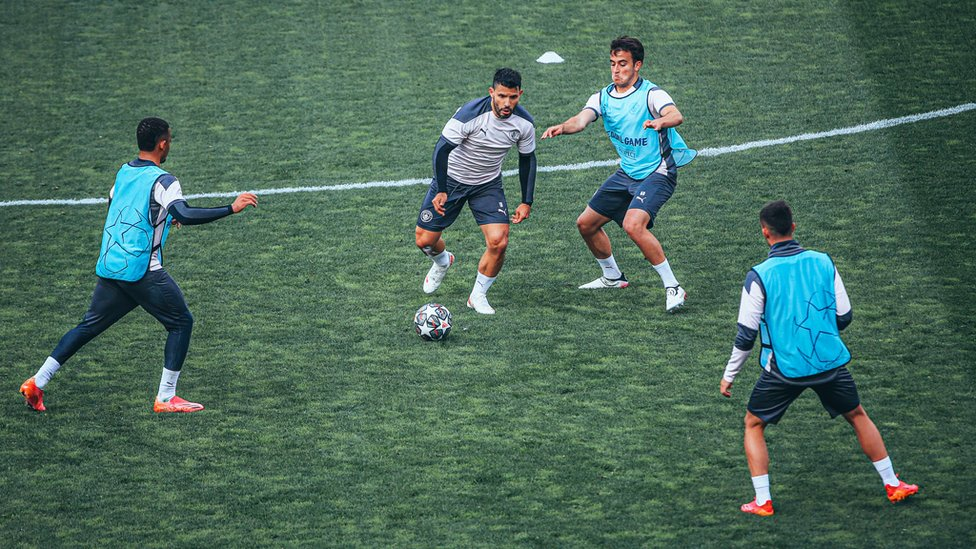 MAN IN THE MIDDLE : Aguero looks to wriggle free under pressure.