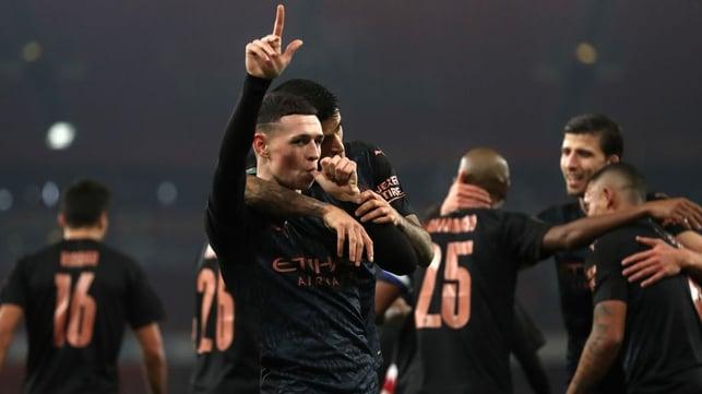 PHENOMENAL PHIL: Our midfielder celebrates with his teammates