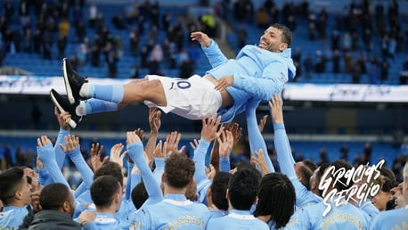 MAIN MAN: The players lift Aguero up into the air!