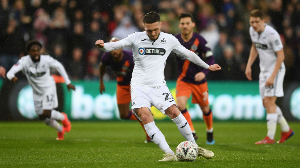 BLOW : Matt Grimes converts the spot-kick to give Swansea the lead