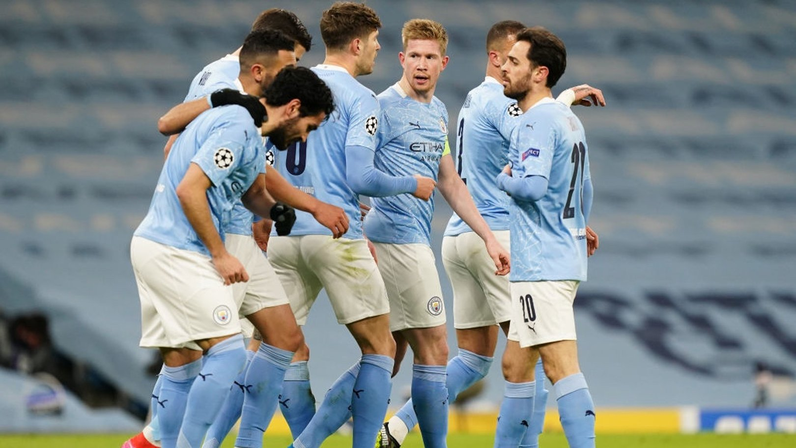 CAPTAIN FANTASTIC: The players gather to celebrate the De Bruyne's goal.