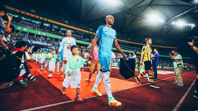 LEADING MAN : Fernandinho leads City out during a pre season friendly against Borussia Dortmund in 2016