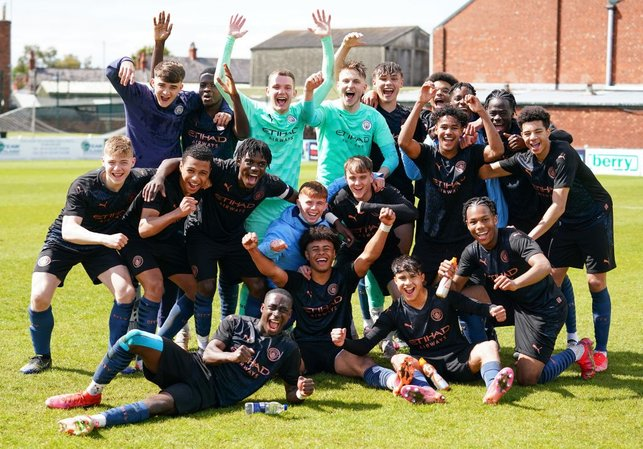 CROWN JEWELS: The victorious City squad are all smiles after sealing the regional league title