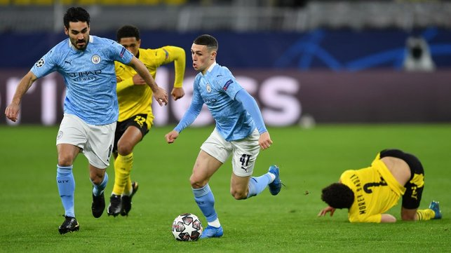 FLYING PHIL: Phil Foden leaves the Dortmund midfield in his wake