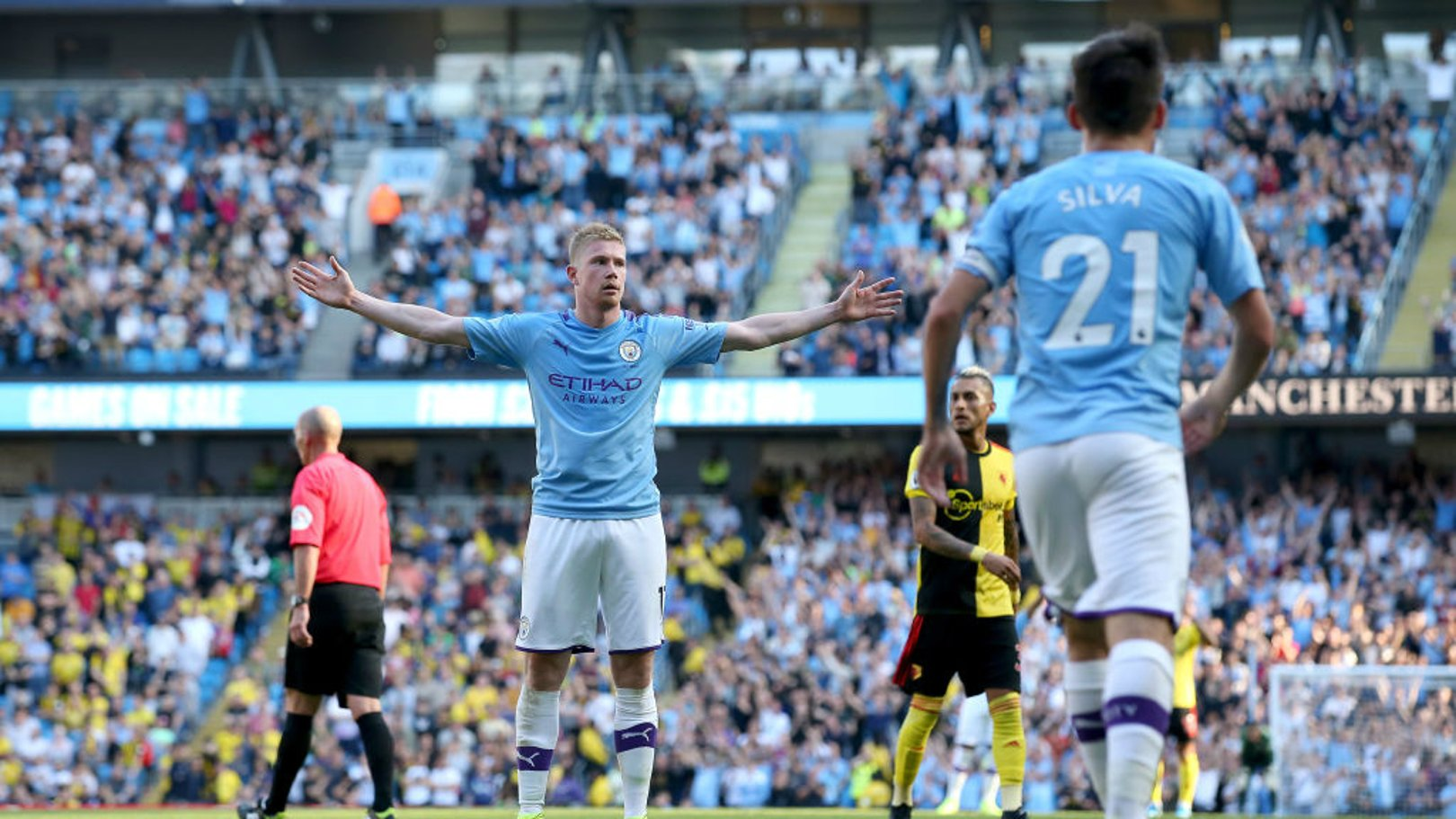 STANDING TALL: Kevin De Bruyne takes the Etihad's applause.