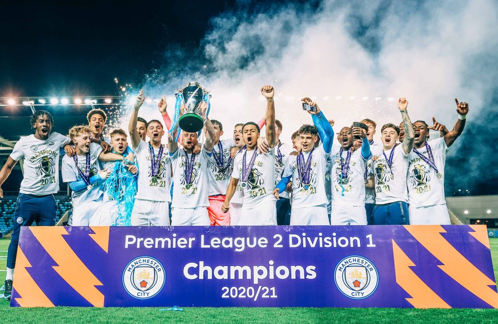 RECORD BREAKERS : The lads secure our very first PL2 title.