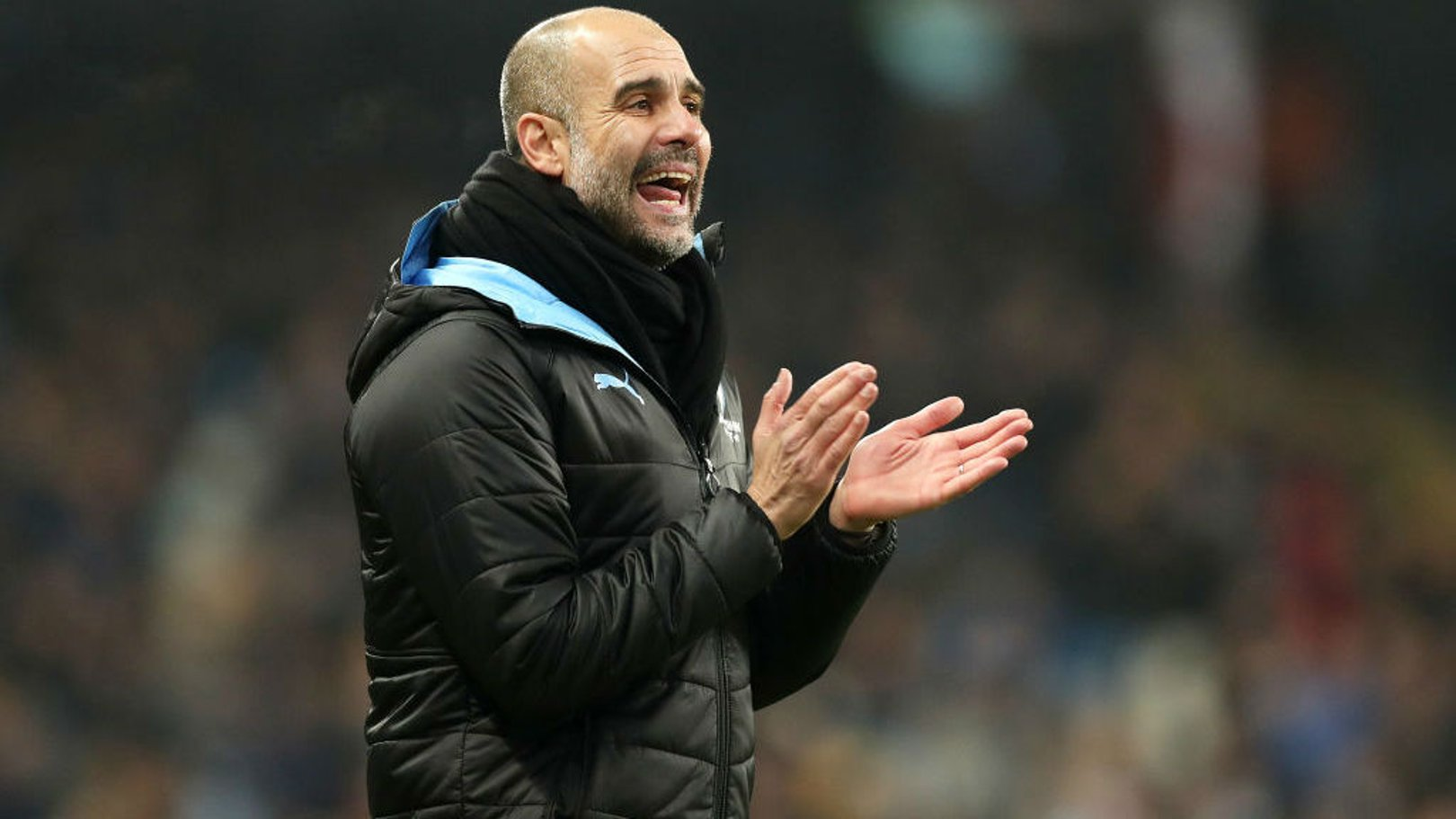 THE BOSS: Guardiola offers encouragement to his players at the Etihad.