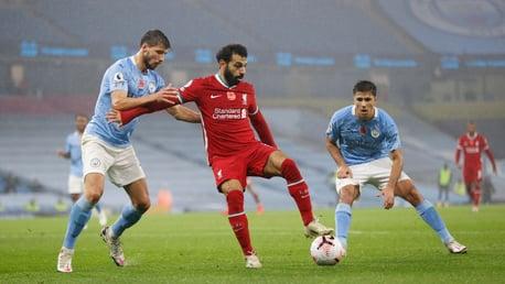 DOUBLE TROUBLE: Ruben Dias and Rodrigo put on the press against Mo Salah