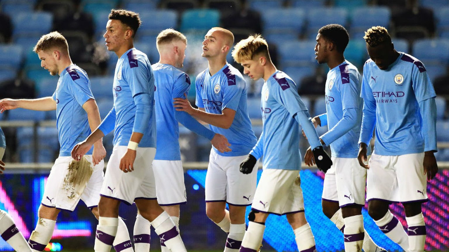 EARLY STRIKE: The City players celebrate after Lewis Fiorini's goal