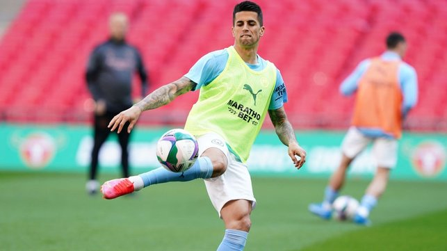 TECHNIQUE : Cancelo volleys the ball during the pre-match warm up.