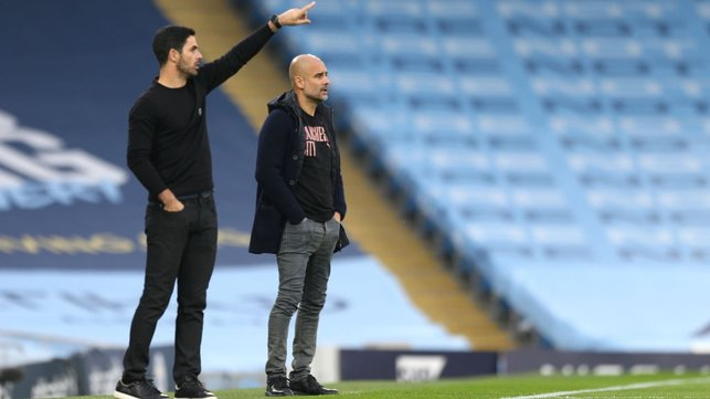 FAMILIAR SIGHT : Guardiola and Artera share the touchline once again at the Etihad.