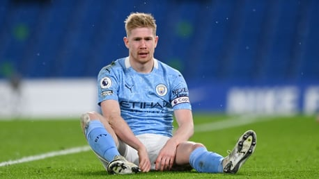 SITTING MIDFIELDER: Kevin De Bruyne goes to ground