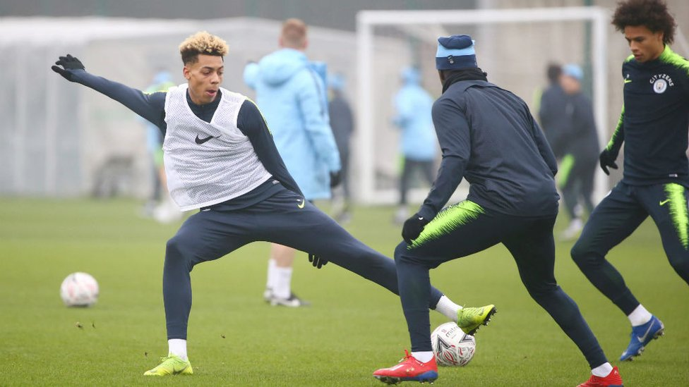 UNDER CONTROL : Felix Nmecha stretches to keep possession
