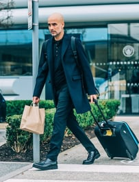 LEADING MAN: The boss cut a stylish dash as always as he headed out for the trip to Greece