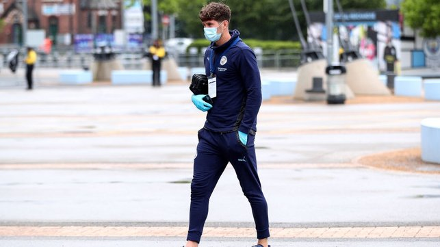 ARRIVAL : Stones makes his way into the Etihad Stadium and is named in the starting lineup.