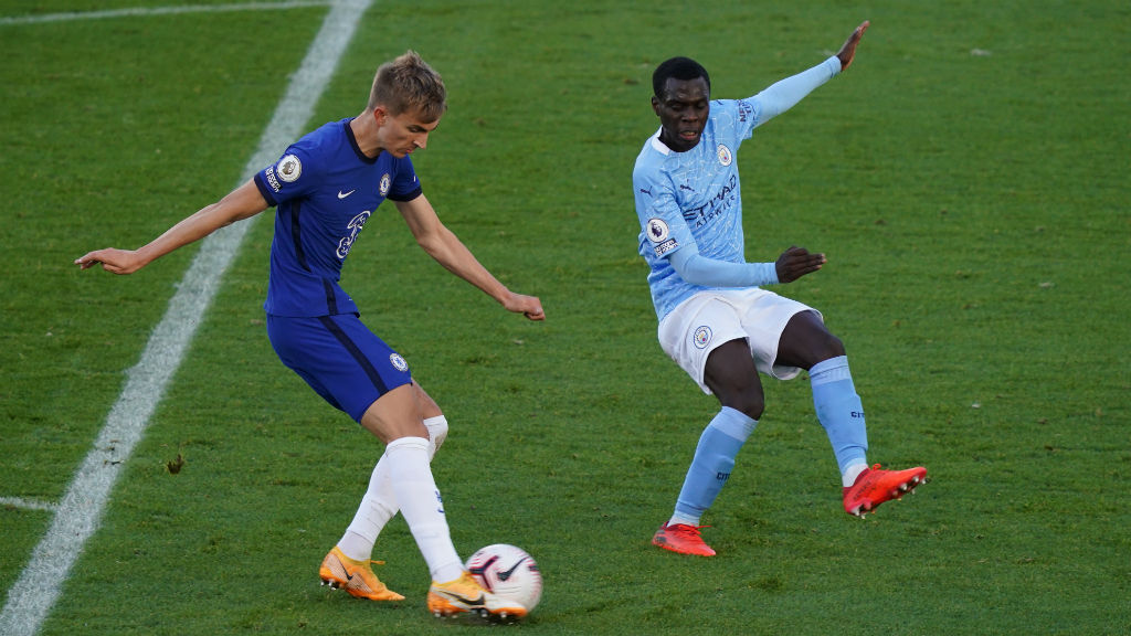NO ENTRY: Claudio Gomes puts the squeeze on Chelsea