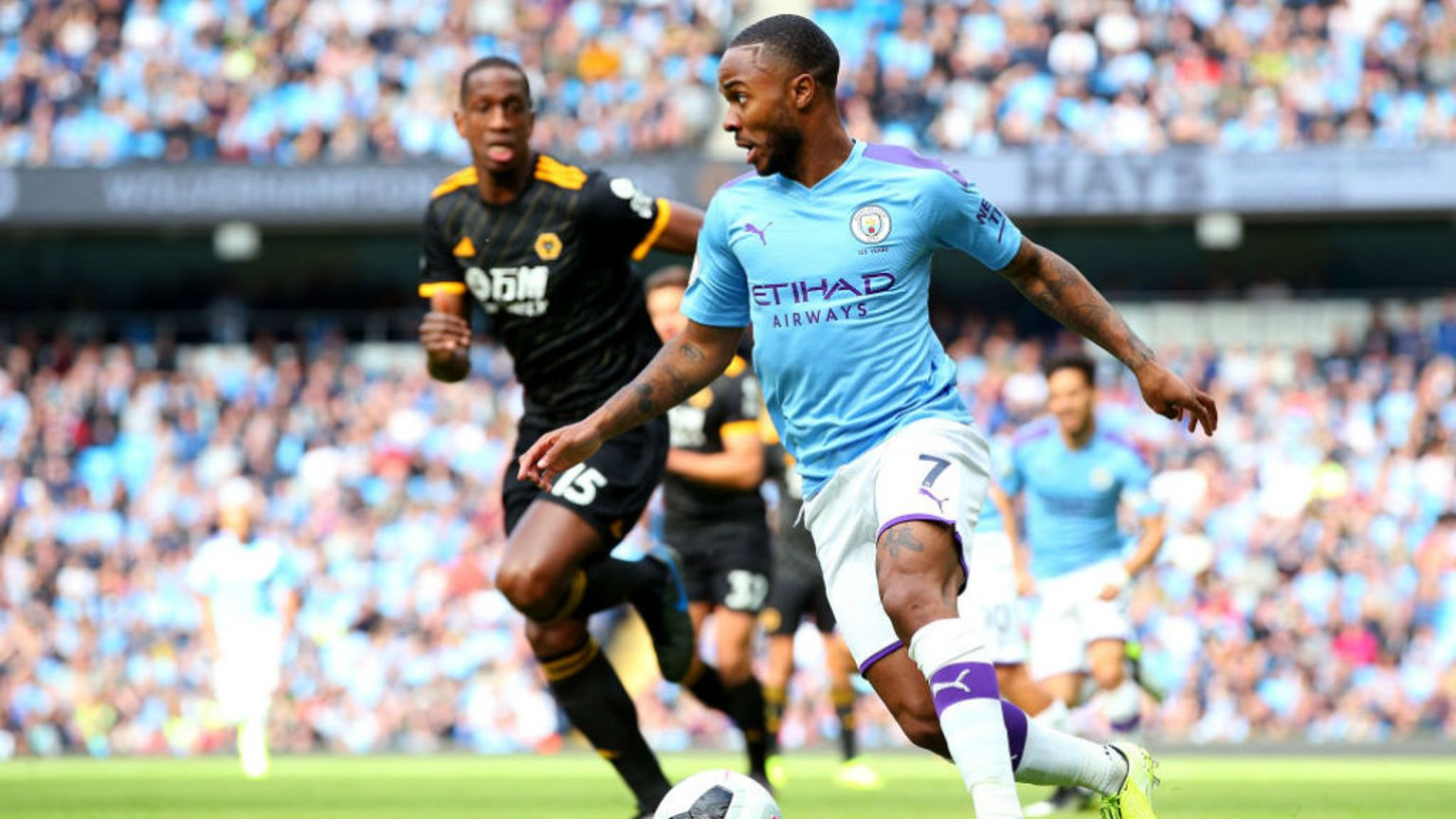 DRIBBLE: Sterling looks to unlock a rigid Wolves defence.