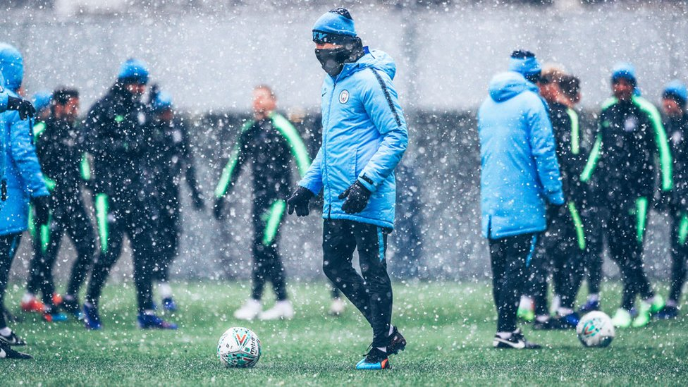 SNOW PATROL : Boss Pep Guardiola keeps out the snow showers as he oversees Tuesday's training session
