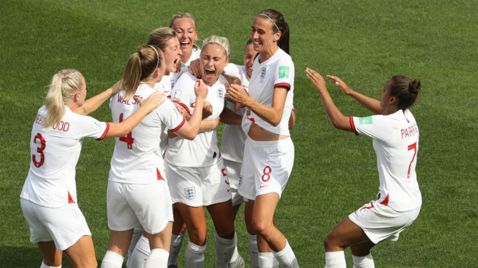 CAPTAIN FANTASTIC: Steph Houghton celebrates with her team-mates after firing England ahead