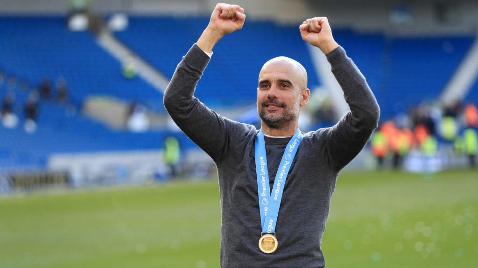 JUST CHAMPION: Pep Guardiola salutes the City fans at Brighton.