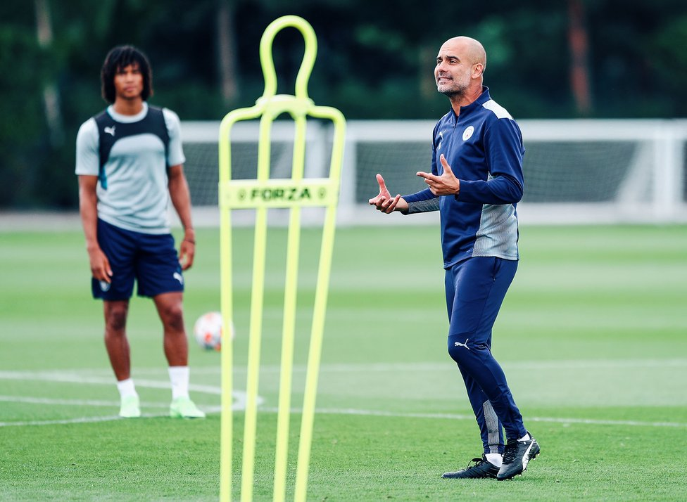 PEP TALK: The boss makes a few pointers as Nathan Ake looks on