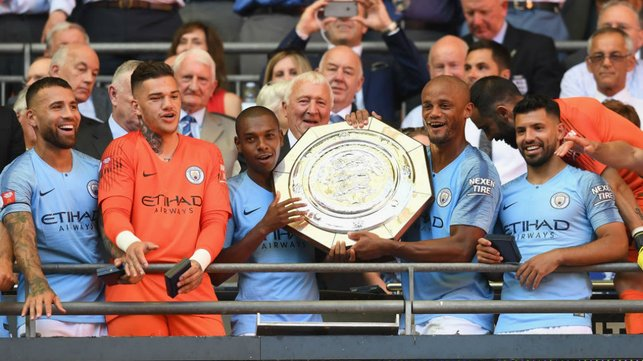 HEAT SHIELD : Ferna proudly lifts the Community Shield aloft with Vincnet Kompany after our 2-0 win over Chelsea in 2018
