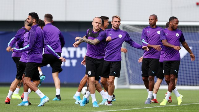 LIMBERING UP : The first team are put through their paces.