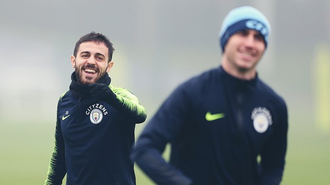 LAUGH-IN : Bernardo Silva shares a smile with Aymeric Laporte