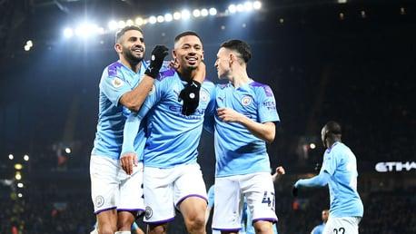 ALL SMILES: Mahrez and Foden celebrate with goalscorer Jesus.