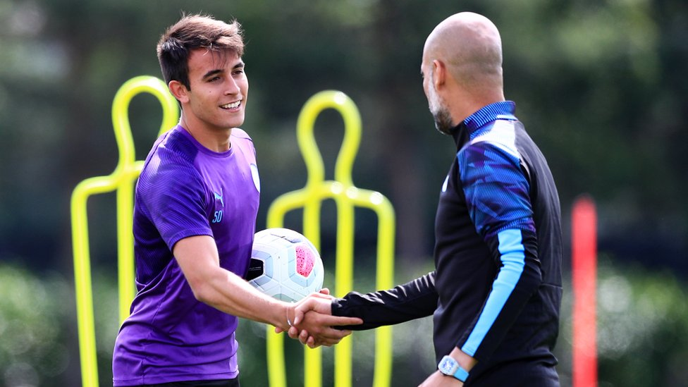 WELCOME BACK : Pep Guardiola greets youngster Eric Garcia