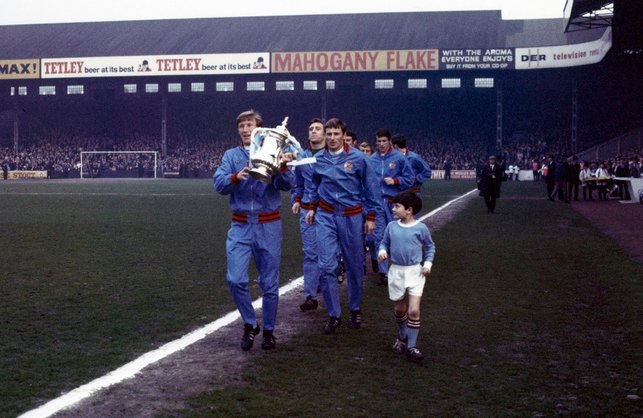 PARADE: Colin holds the FA Cup aloft at Maine Road in 1969