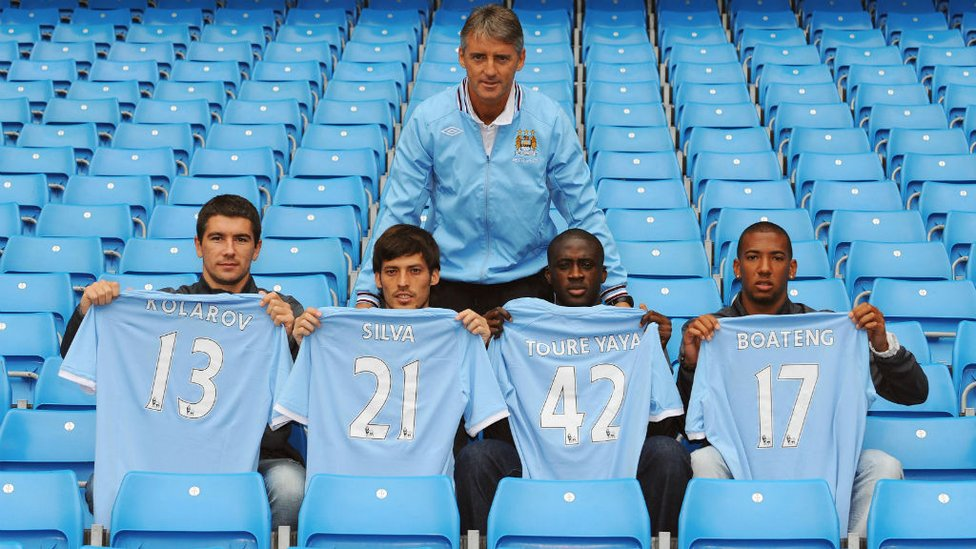 DONE DEAL : David Silva first signed for City back in the Summer of 2010, here is he pictured with fellow signings Aleksandar Kolarov, Yaya Toure and Jerome Boateng and former boss Roberto Mancini.