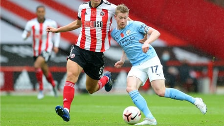 LEADING MAN: Skipper Kevin De Bruyne shrugs off a challenge as the action hots up