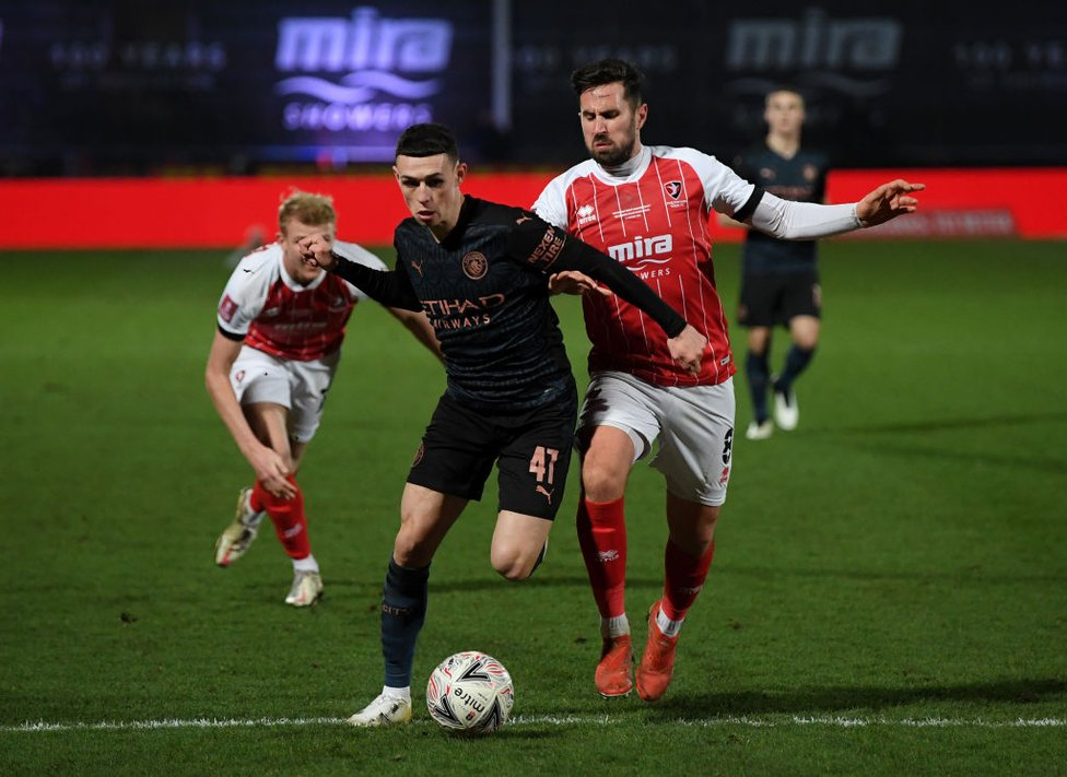 ON THE HUNT : Phil Foden tries his best to break down Cheltenham's defence
