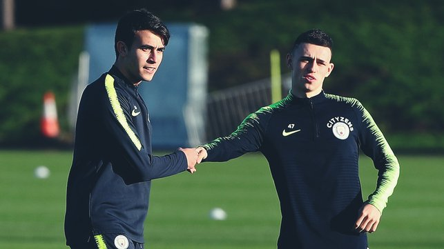 YOUNG STARS : Eric Garcia gives Phil Foden a helping hand