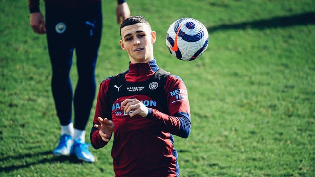 FODEN FOCUS: Phil Foden keeps his eye on the ball