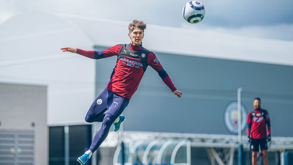 EYES ON THE PRIZE : A focused John Stones rises high.