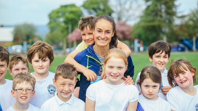 SMILES : The kids enjoyed practising their football skills with Tess