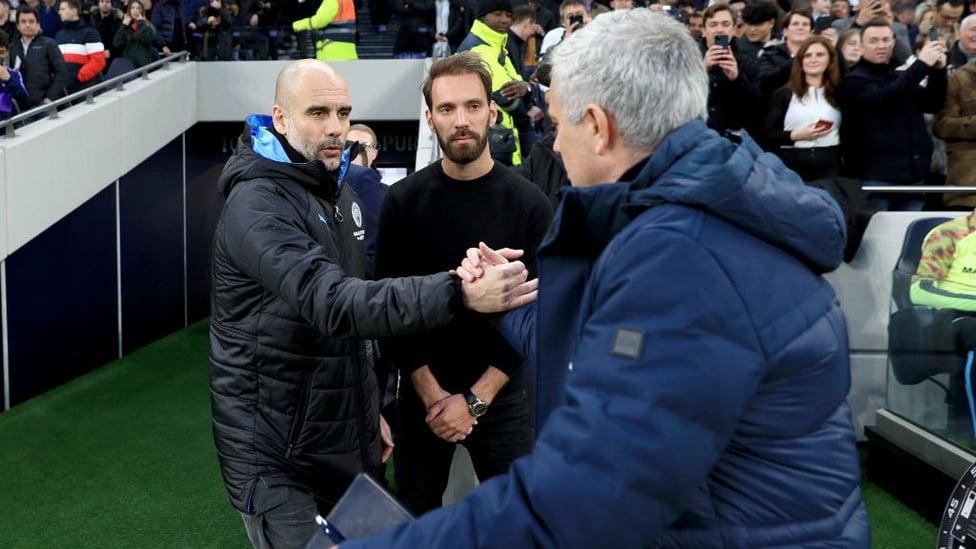 GAFFERS : Guardiola and Mourinho share a handshake ahead of kick-off.