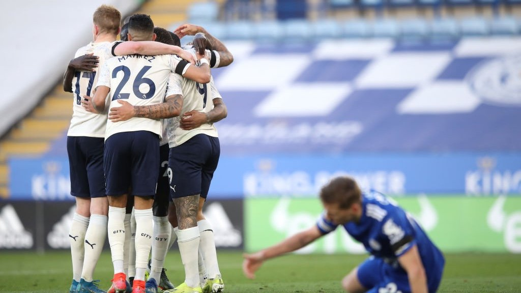 GROUP HUG: Jesus feeling the love after scoring the second goal of the game.