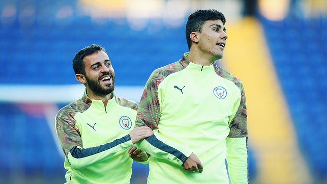 TWO'S COMPANY : Bernardo Silva and Rodrigo limber up ahead of tomorrow's Shakhtar clash
