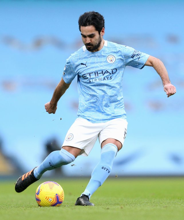 MIDFIELD MAESTRO : Gundogan gets ready to spray a pass as City dominate after the interval.