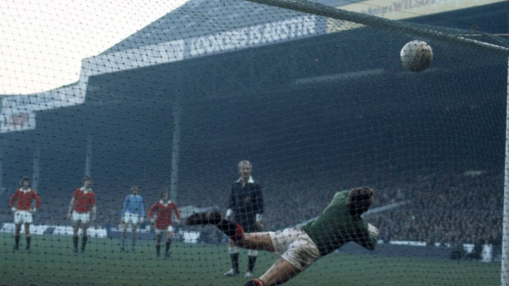 SPOT ON: Francis Lee lashes home from the penalty spot against Manchester United