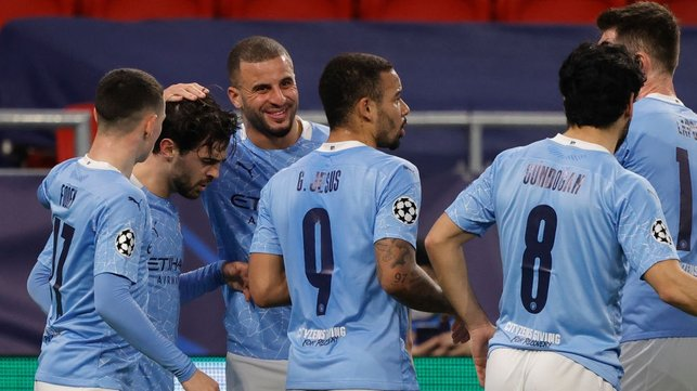BER-NODDO : The players gather to congratulate Bernardo after his accurate headed goal after 29 minutes.