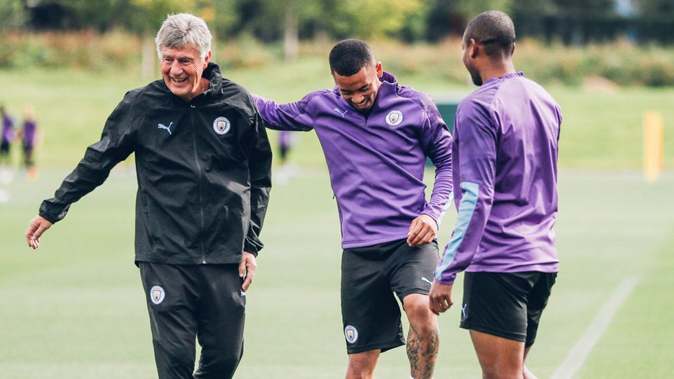 THREE CHEERS : Coach Brian Kidd shares a smile with Gabriel Jesus and Fernandinho